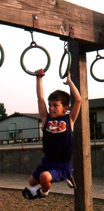 Lee on the monkey bars.