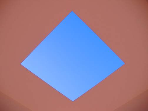 The opening in the ceiling if the installation Tending (blue). A photograph does not do justice.
