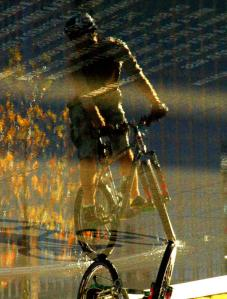 Bike rider in front of the Winspear Opera House. If you are wondering, the photo is cropped and upside down.