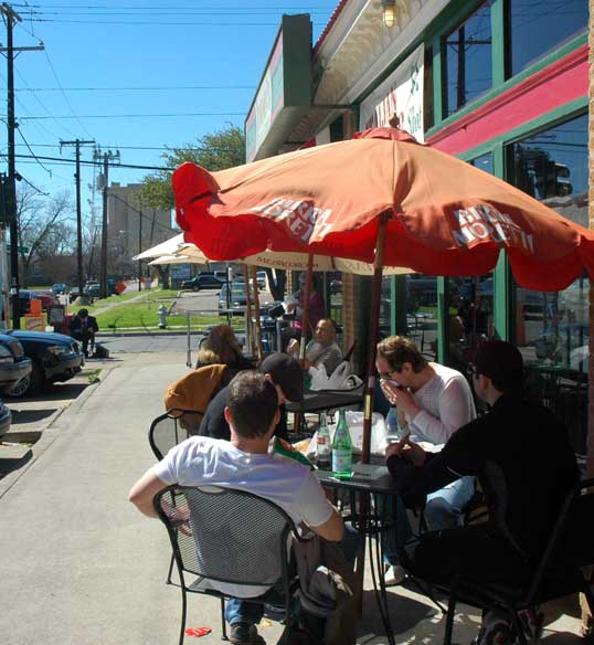 Seating out on the street at Jimmy's Food Store.