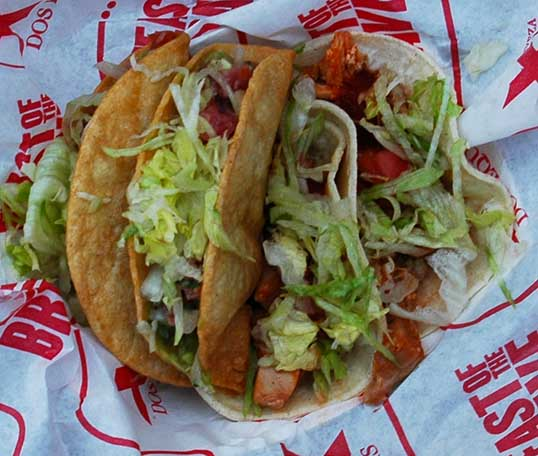 Two Shark Tacos on the left, and two Mystery (Iguana) tacos on the right.