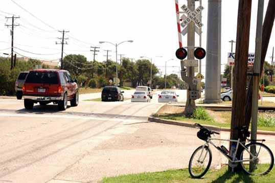 Rail crossing on Arapaho road.