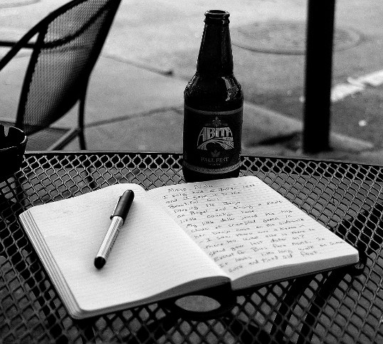 Writing in my Moleskine Journal outside the Mojo Lounge, Decatur Street, French Quarter, New Orleans