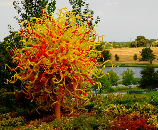Chihuly with Winfrey Point in the background, across the water.
