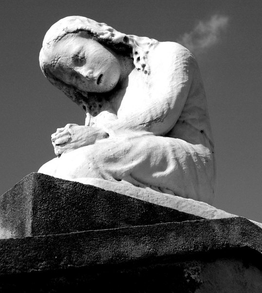 Statue on top of a crypt, Saint Louis Cemetery Number One, New Orleans