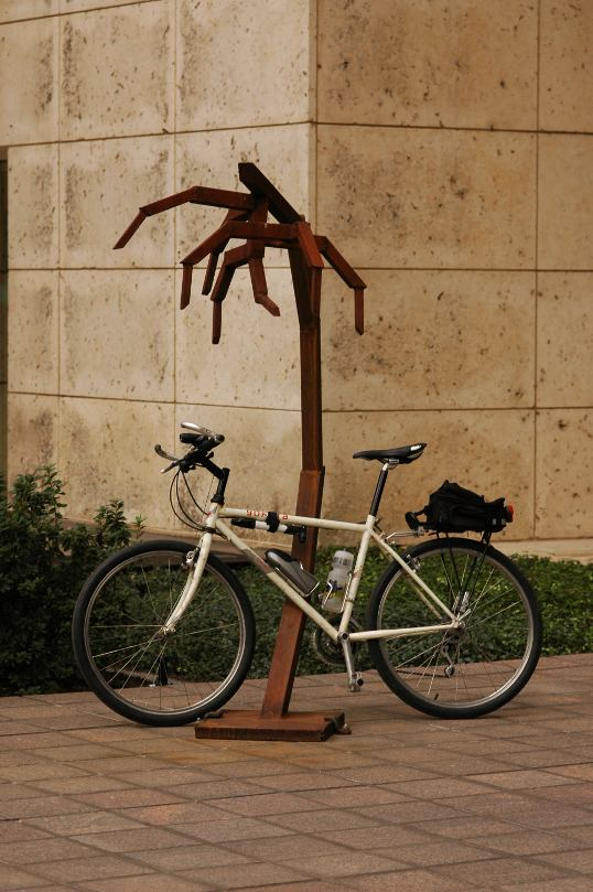 My commuter bicycle, leaning up against the mystery sculpture.