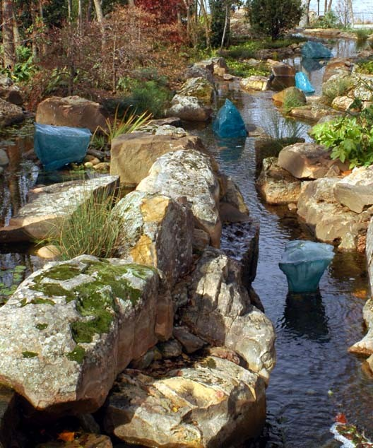Chihuly glass sculptures in the creek, Dallas Arboretum