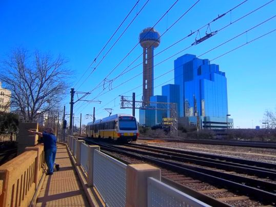 This is the walkway along the rail tracks over the underpass, with the Dallas Hyatt Regency and Reunion Tower in the background.