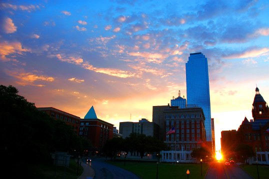 A wide angle view of Dealey Plaza at dawn on the morning henge day (or two days later). The brick building in shadow on the far left is the infamous Texas Schoolbook Depository. President Kennedy was shot on the curved road on the left, almost fifty years ago.
