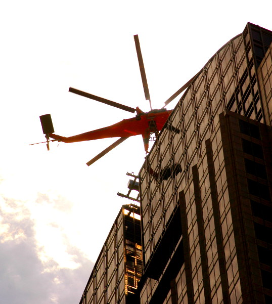 Sikorsky S-64 delivering a load to the top of the Chase Tower, Dallas, Texas