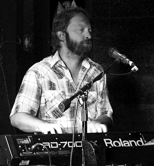 Chad Stockslager playing keyboards with The Buick 6