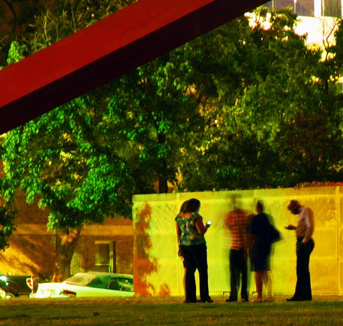 A group of friends in front of the Dallas Museum of Art, night, long exposure