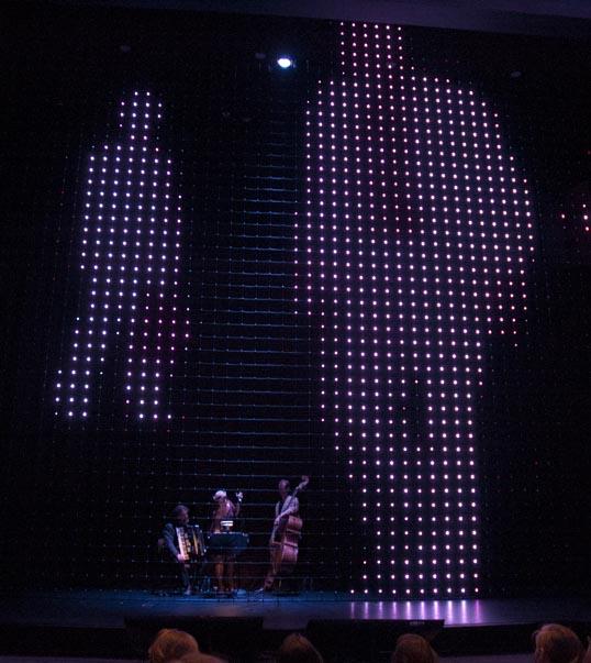 Shane Pennington's screen inside the Dallas City Performance Hall, with Jazz Trio.