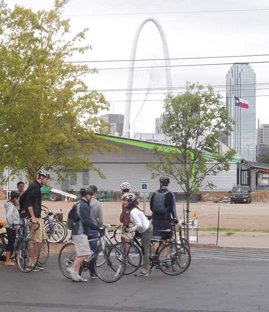 Leaving Four Corners Brewery, with downtown Dallas, and the Margaret Hunt Hill bridge in the background.