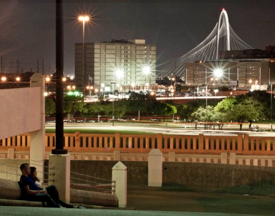 Couple watching the show. Dallas, Texas. Margaret Hunt Hill Bridge in the background.