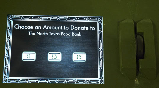 I donated five dollars to the North Texas Food Bank. You swipe your credit card, push the button. There's an artificial splash and the  cash projected on the fountain swirls around in a virtual splash