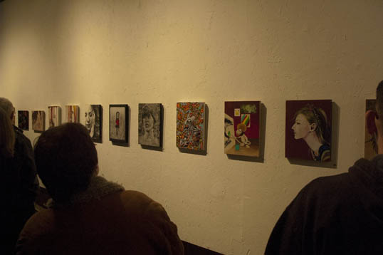 A row of paintings. I chose the one in the middle.