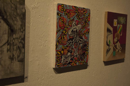 Clay Stinnett painting on the wall at Kettle Gallery.