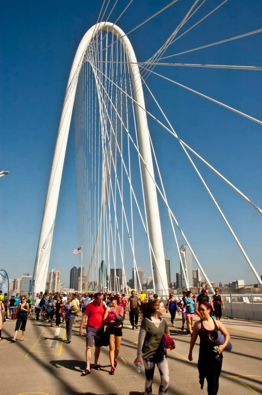 People walking from the yoga event with their mats under their arms. All Out Trinity Festival - Margaret Hunt Hill Bridge, Dallas, Texas (click to enlarge)