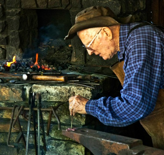Blacksmith forging a cross, Dallas Heritage Village (click to enlarge)