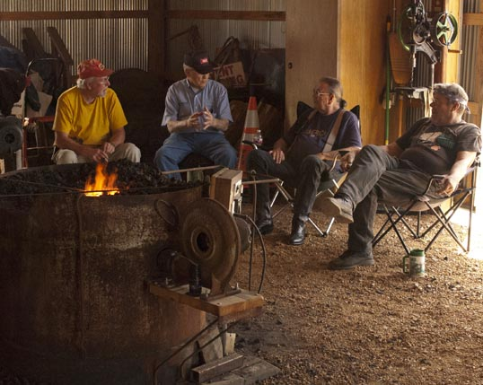 The blacksmiths sitting around, talking shop.