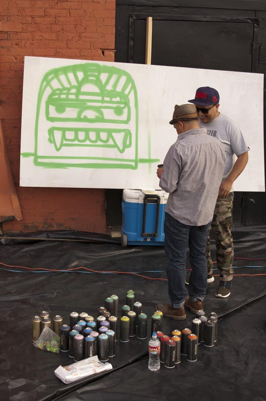 Sour Grapes planning their mural