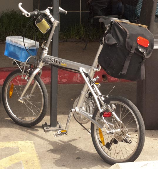 My Xootr Swift bike with picnic supplies loaded in the pannier.