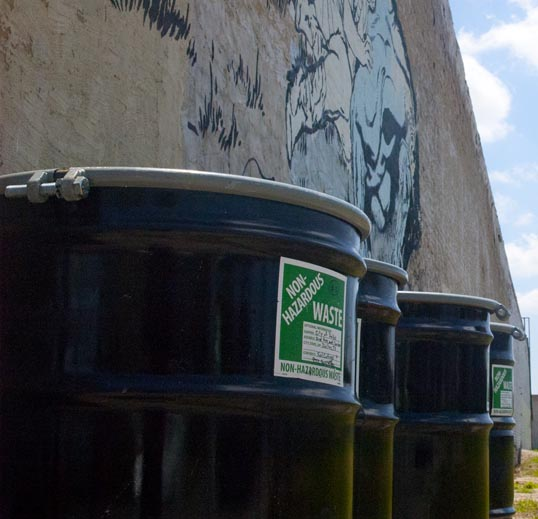 The mural was decorated by non-hazardous waste drums.