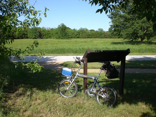 The view of trail, meadow, and trees. You would never know you were in the middle of a gigantic city. The historical information was in the sign my bike is leaning on. Plano, Texas.
