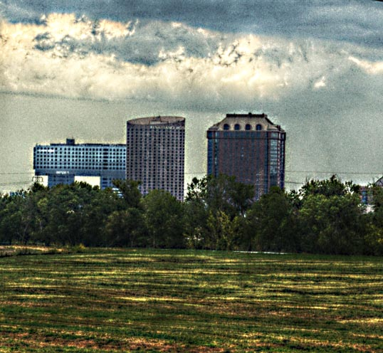 The Anatole Hotel, the Renaissance Dallas, and the new Parkland Hospital, from the Trinity river floodplain,  Dallas, Texas