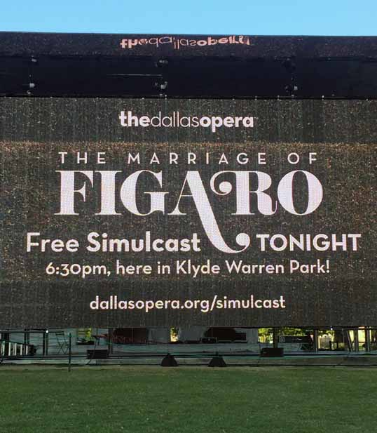 The Opening Credits on the screen in Klyde Warren Park