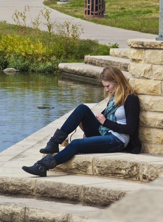 Woman writing in a Moleskine Notebook, Wichita, Kansas