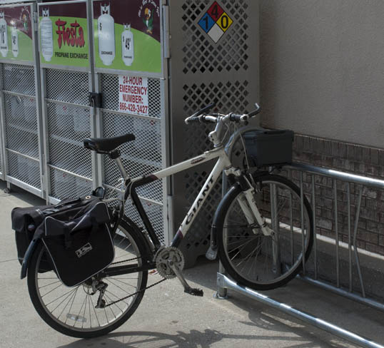 My commuter bike, with panniers, waiting at the Fiesta Mark bike rack.