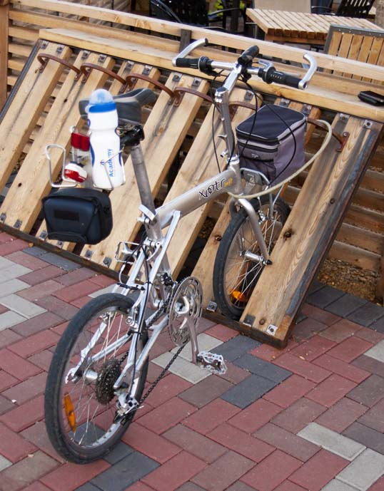 My Xootr Swift folding bike in the cool bike rack in front of the Cold Beer Company Deep Ellum, Dallas, Texas