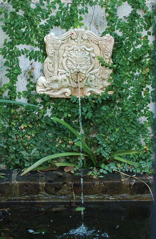 Fountain in a cool interior garden, New Orleans, Louisiana