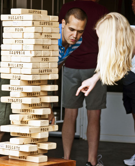Giant Jenga requires careful planning.