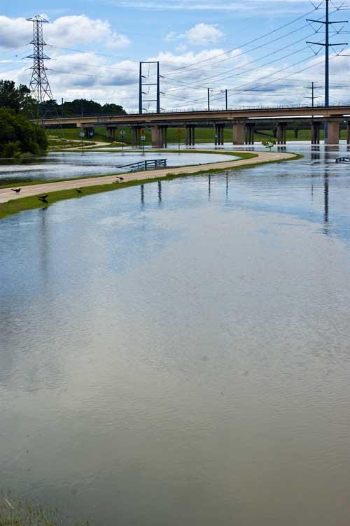 The Santa Fe Trestle Trail snaking its way through the flooded Trinity River Bottoms. Dallas, Texas.