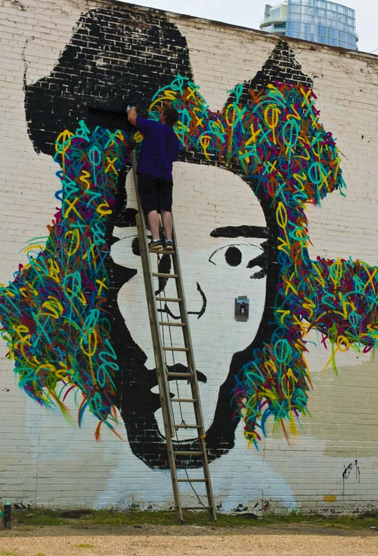 Eric Mancini painting a mural of Jean-Michel Basquiat Downtown Dallas, Texas