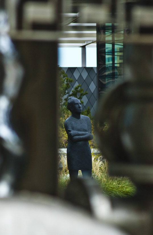 Hall Sculpture Garden Dallas, Texas Background: Reflection Series XI Deborah Ballard 2011, Cast Stone, Mixed Media Foreground (blurred) The Stainless Internet George Tobolowsky