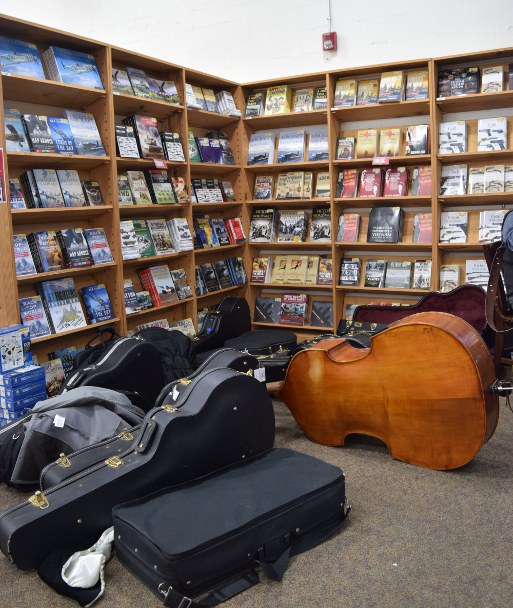 Music cases and used books... and a bass.